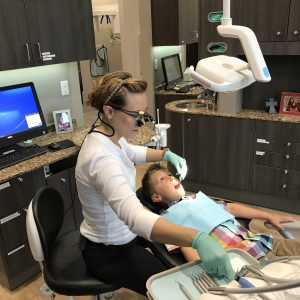 Dr. Spencer Working on Young Dental Patient