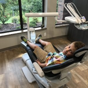 Young Patient Enjoying Dental Operatory with a View